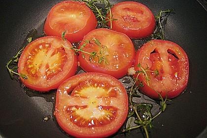 Lammfilet an Wirsing, geschmorten Tomatenscheiben und gebratenen Kartoffelvierteln 3