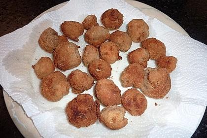Panierte und frittierte Champignons (Bild)