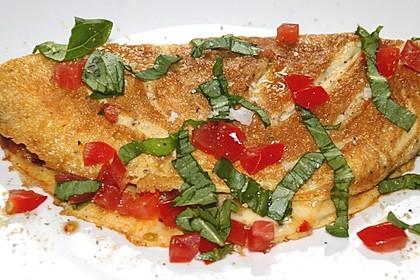 Omelett mit Käse und Tomaten (Bild)