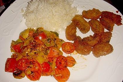 Vegetarische Gemüsepfanne mit Reis und frittierten Champignons
