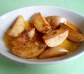 Würzige Kartoffelecken (Bild)