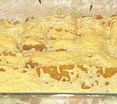 Fischstäbchen auf Kartoffelpüree (Bild)