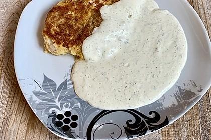 Paniertes Schnitzel mit Frischkäse - Sahne Sauce (Bild)