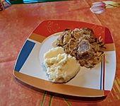 Überbackenes Schweinefilet mit Senfkruste (Bild)