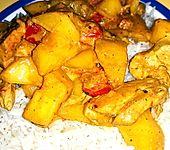 Brasilianisches Hühnchen mit Kokosmilch und Mango (Bild)