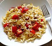 Nudeln mit karamellisiertem Schnittlauch und Tomaten (Bild)