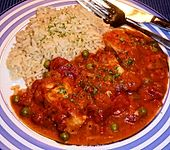 Fisch in Tomatensoße (Bild)