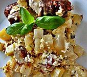 Überbackener Kartoffel-Kohlrabi-Bratwurst-Auflauf für 2 Personen (Bild)