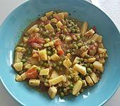 Kartoffelcurry mit Erbsen und Tomaten (Bild)