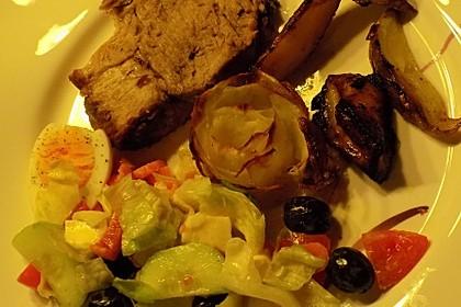 Schweinebraten mit Kartoffeln italienischer Art