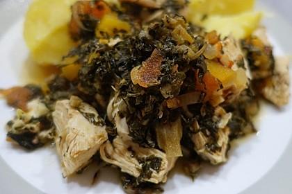 Callaloo jamaikanische Art mit Hühnchen