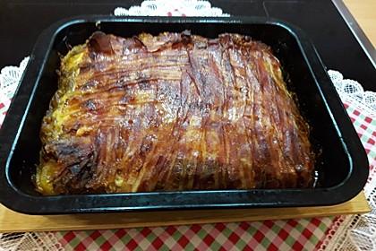 Kartoffelauflauf in Frühstücksspeck