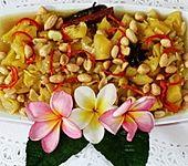 Ananasstücke scharf und würzig als Beilage (Bild)