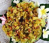 Avocadostücke mit gewürzter Ananas (Bild)
