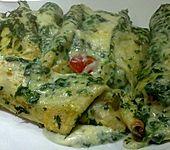 Überbackene Pfannkuchen mit Spinatfüllung (Bild)