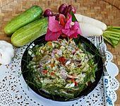 Gemischter Rettichsalat mit Gurken und Paprika (Bild)