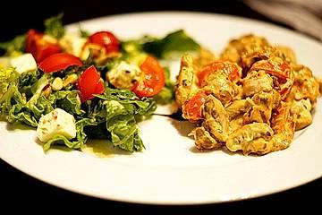 Hähnchengeschnetzeltes mit Champignons und Tomaten