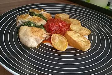 Welsfilet an Babyspinat-Basilikum-Pesto mit Tomatenconfit und Ofenkartoffeln