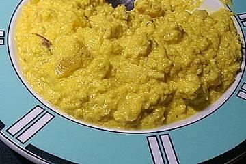 Hähnchen mit Blumenkohlreis in fruchtiger Currysauce