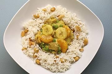 Geschnetzeltes mit Mandarinen und Erdnuss - Reis